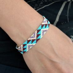 Geometric Ikat / Navajo Inspired Beaded Bracelet. I could make one of these on my bead loom! if I can find it....