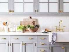 Having a Moment: Blue-Gray Kitchen Cabinets via @MyDomaine