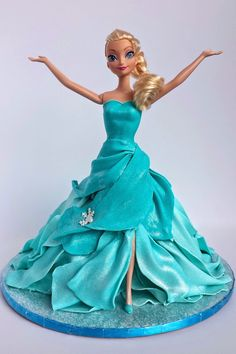 """I made this Elsa doll cake for my niece who absolutely loves Frozen . I was looking to replicate the scene where she sings """"Let it . Torte Frozen, Frozen Doll Cake, Elsa Doll Cake, Frozen Theme Cake, Bolo Barbie, Barbie Cake, Doll Cake Tutorial, Fondant Tutorial, Elsa Cakes"""