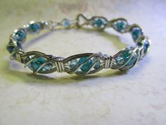 Twists n Turns Bracelet -TNT with Ronda Stevens. This workshop will introduce you to several gauges of dead soft square wire. You will begin to understand how to bend the wire and shape it to your needs. You will be shown how to wrap with half round wire and create your own unique clasp for your bracelet.