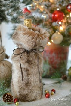 Host/Hostess Present: Nicole Miller Faux Fur Champagne or Wine Bottle Gift Wrap | #Christmas #NewYearsEve #bestgiftever #sp #homegoodshappy | Fox Hollow Cottage