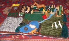 Knitted farm play mat - no reason why you couldn't crochet one. st