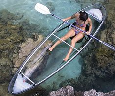 See Through Bottom Canoe.  (With kayak paddle?)  Anyway, looks like great fun in clear waters!