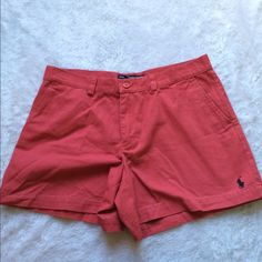 Ralph Lauren short salmon color 🎉 Worn a couple of times🎉 Please ask for additional pictures, measurements, or ask questions before purchase. 🎉 No trades or other apps 🎉 Ships next business day, unless noted in my closet  🎉 Bundle for discount Ralph Lauren Shorts