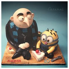 Mr Greo and a minion  - Cake by Ebtehal