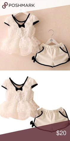 Dressy lace peplum top and matching shorts Perfect 1st day of school outfit or a birthday party.  Worn once.  Size:4-5 Years;Waist:19-21cm;Top Length:41cm;Chest:36cm Shorts Length:22cm Matching Sets