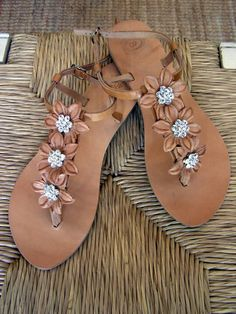 Handmade leather sandals with leather flowers and metallic daisies with swarovski rhinestones