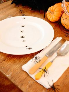 Give inexpensive white dinner plates a creepy Halloween makeover with black ceramic paint and easy-to-create bug silhouettes.  #Halloween #crafts