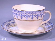 Edward Asbury Antique Corinthian Blue and White Vintage Porcelain Tea Cup and Saucer. 1875-1915