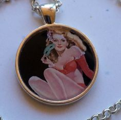1 inch round pendant with chain Pinup by LaughingAppleDesigns, $10.00