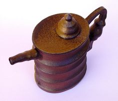 Oil drum tea pot by anartfulhouse on Etsy, $245.00    I love this!!  Very steam punk, very cool!