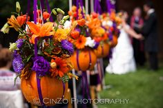Fall wedding in orange and purple - would be adorable as centerpieces!