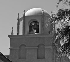 A photograph of three bells in a bell tower in black and white. To purchase please go to http://memoriesoflove.imagekind.com