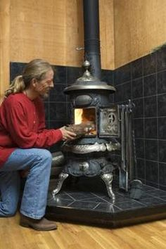 Freestanding wood stoves add warmth, ambiance and style to any room of the house. If you're planning on adding a wood stove to an existing room, you also need to construct a raised hearth to protect the flooring beneath the stove from heat. Wood Stove Wall, Wood Stove Hearth, Stove Fireplace, Wall Wood, Antique Wood Stove, How To Antique Wood, Into The Woods, Buck Stove, Bedrooms