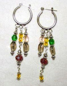 Crystal of Colors Earrings  $10.50  plus 2.25 shipping  Looking for a pair of earrings that are exciting. Look no further this pair has Smoky Ovals, Yellow, Pink & Green Crystals enhance the purple Swarovski. Many colors to go with many outfits.