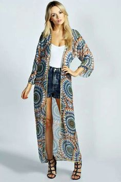 Pair a super long kimono with shorts and heels so it doesn't overpower you.   Read more: http://www.gurl.com/2014/05/31/style-tips-how-to-wear-kimono-jackets-cardigans-sweaters-outfit-ideas/#ixzz3jNONEoaD