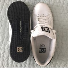 Women's DC skater shoes White/ Black skater shoes with feminine detailing. Worm a few times, have a few scuffs but soles barely have any wear. DC Shoes Sneakers