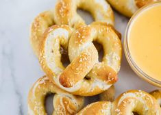 Homemade pretzels that are soft and fluffy on the inside with a chewy and salted exterior. Easy to make and absolutely no rising time needed!