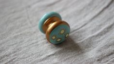 painted dresser knobs, turquoise, gold, cream, cabinets and wood furniture.