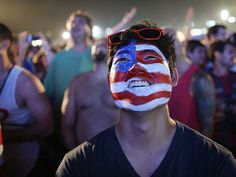 An American soccer fan watches a live broadcast of the soccer World Cup match between Ghana - USA 1:2