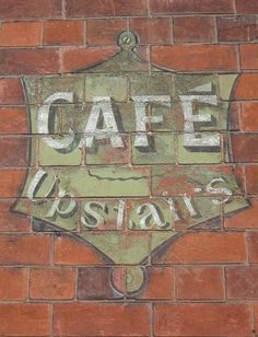Cafe Upstairs ghost sign in Grantham, Lincolnshire