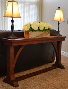 This narrow sofa table is a stylish piece for behind the sofa or to use as a console table in the hall. Easily adjust the dimensions for height or length to fit perfectly in your space. If you don't have tools to cut curves, substitute straight boards. Get the free DIY plans from @hertoolbelt at buildsomething.com