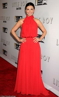 Lady in red: Little Boy star Ali Landry wore a fabulous flowing red gown...