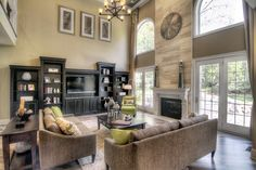two story great room with stunning fireplace