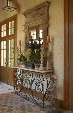 Love the mirror, tall candle pillars, and hydrangeas