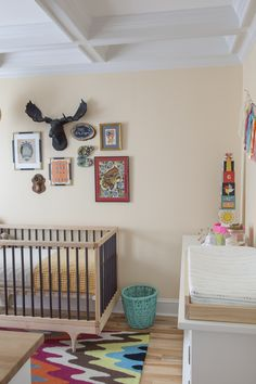 We love the way that one of our clients has used The Leonard, our large black faux moose head, in her nursery! Gender neutral nursery design | 100 Layer Cakelet