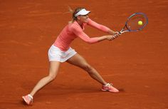 Mutua Madrid Open - Day Two - Maria Sharapova of Russia stretches to play a backhand against Timea Bacsinszky of Switzerland in their second round match during day one of the Mutua Madrid Open tennis tournament at the Caja Magica on May 3, 2015 in Madrid, Spain.