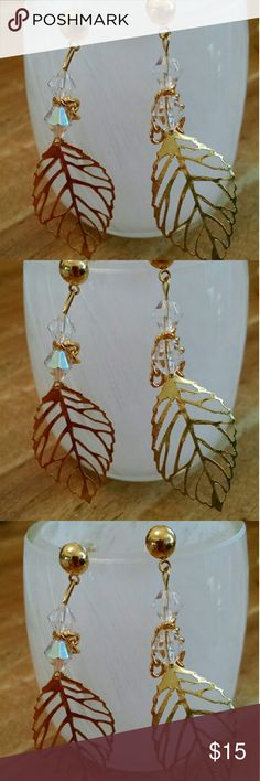 """Brand new handmade!!! Delicate Leaf Earrings Brand new handmade. No one else will have a pair like it! Beautiful gold leaves with tiny golden chain accents and Swarovski crystals. About 2"""" drops. Made to last forever. Jewelry Earrings"""