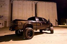Dodge Ram Truck jacked lifted black