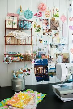 Organize craft room supplies with a wall mounted wire basket.
