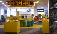 Library Midden Brabant, Tilburg, February 2009. The Library Midden-Brabant is one of the six largest libraries in the Netherlands. While awaiting a new location, the ground floor and first floor of the existing property have been newly furnished. To make the collections more recognisable, M+R thought up a series of bright colours that serve as a code.