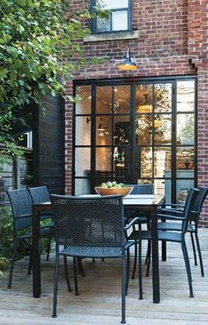 lovely windows, light and deck! Brick House Trim, Black Trim Exterior House, Black Exterior Doors, Steel Doors And Windows, Black Windows, French Windows, Red Brick Homes, Frames Ideas, Wall Ideas