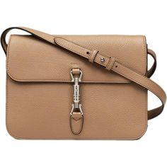 Emma Stone wearing Gucci Jackie Soft Leather Flap Shoulder Bag