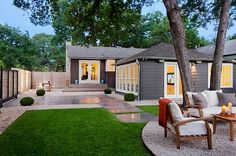 Balanced mix of grassy areas and gravel seating area. This backyard is so nice! Must incorporate this into the Shore House backyard.