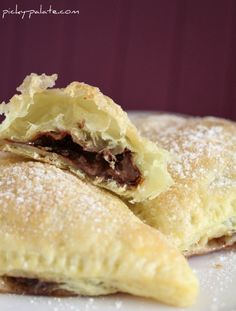 Nutella-Mallow Pillow Pockets 1 package puff pastry, 2 pastry sheets thawed 1 Cup Nutella spread 1 Cup mini marshmallows Egg white wash: 1 egg white whisked with 1 Tablespoon water Powdered sugar for dusting 1.  Preheat oven to 350 degrees F.  Cut each square of pastry into 4 equal size pieces (I trimmed mine just …