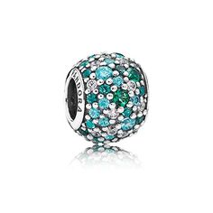 Get into the summer mood! Add this glittery pavé charm with multiple hues of oceanic green to your tropical bracelet design. Crafted from sterling silver featuring 78 hand-set stones, this artistic charm is a true representation of PANDORA's outstanding craftsmanship. #PANDORAcharm