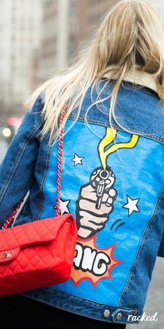 """Bang"" Customized Denim Jacket Worn With a Red Chanel Quilted Bag at New York Fashion Week // More Winter Style Ideas from the Best NYFW Fall 2016 Street Style: (http://www.racked.com/2016/2/12/10966400/nyfw-street-style-fall-2016)"