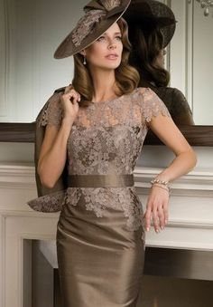 mother of the bride dress with matching hat. Don't like the hat but the dress is great, maybe in a different colour though.