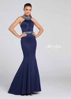 Ellie Wilde EW117082 - Sleeveless jersey mermaid gown with elaborately jeweled high halter collar, matching jeweled waistband and center back bodice, princess seams, slight train.