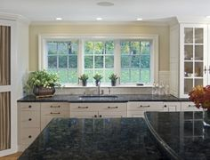 Luxury Blue Granite Countertops with White Cabinets