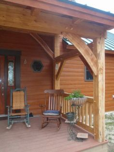 Timber Frame Entry Porch w/ Live edge braces.  By Black Dog Timberworks, LLC