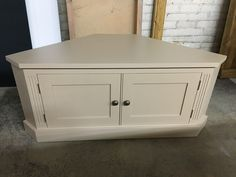 Corner TV unit painted in F&B Smoked Trout. Cobwebs Furniture Company.
