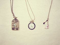 how we love necklaces with interesting pendants... almost vintage looking... a bird cage... a watch.. a tea cup and spoon!