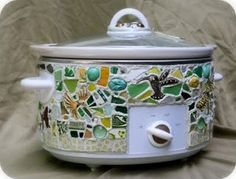 Kathleen is the genius behind theawesome idea of artisan crock pots. She loved using her crock pot but the artist in her hated seeing something not that beautiful on the counter top constantly. So she makes these beauties...