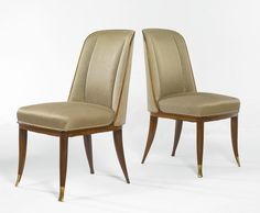 "Emile-Jacques Ruhlmann: pair of ""Bossman"" chairs, rosewood, gilt bronze and upholstery; 35 1/2 in. (90 cm) high. Circa 1925"