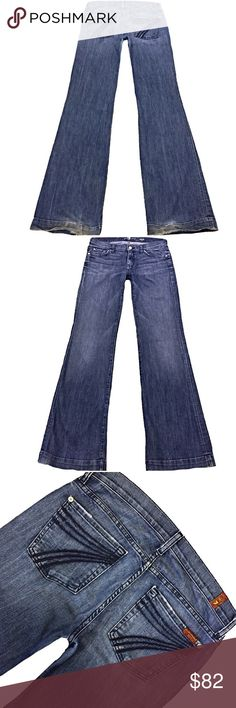 """7 For All Mankind """"Dojo"""" SZ 28 Inseam 36"""" A Super Cute Pair Of 7 For All Mankind """"Dojo"""" Women's SZ 28 Flare Leg Med Blue Wash Blue Stitched 7 Mid-Rise Stretch Jeans. Wear on hem  Style# AU115Y702G Cut# 012557 Measurements: Waist: 31"""" Hips: 40"""" Front rise: 8.5"""" Back rise: 13.5"""" Inseam: 36"""" 7 For All Mankind Jeans Flare & Wide Leg"""